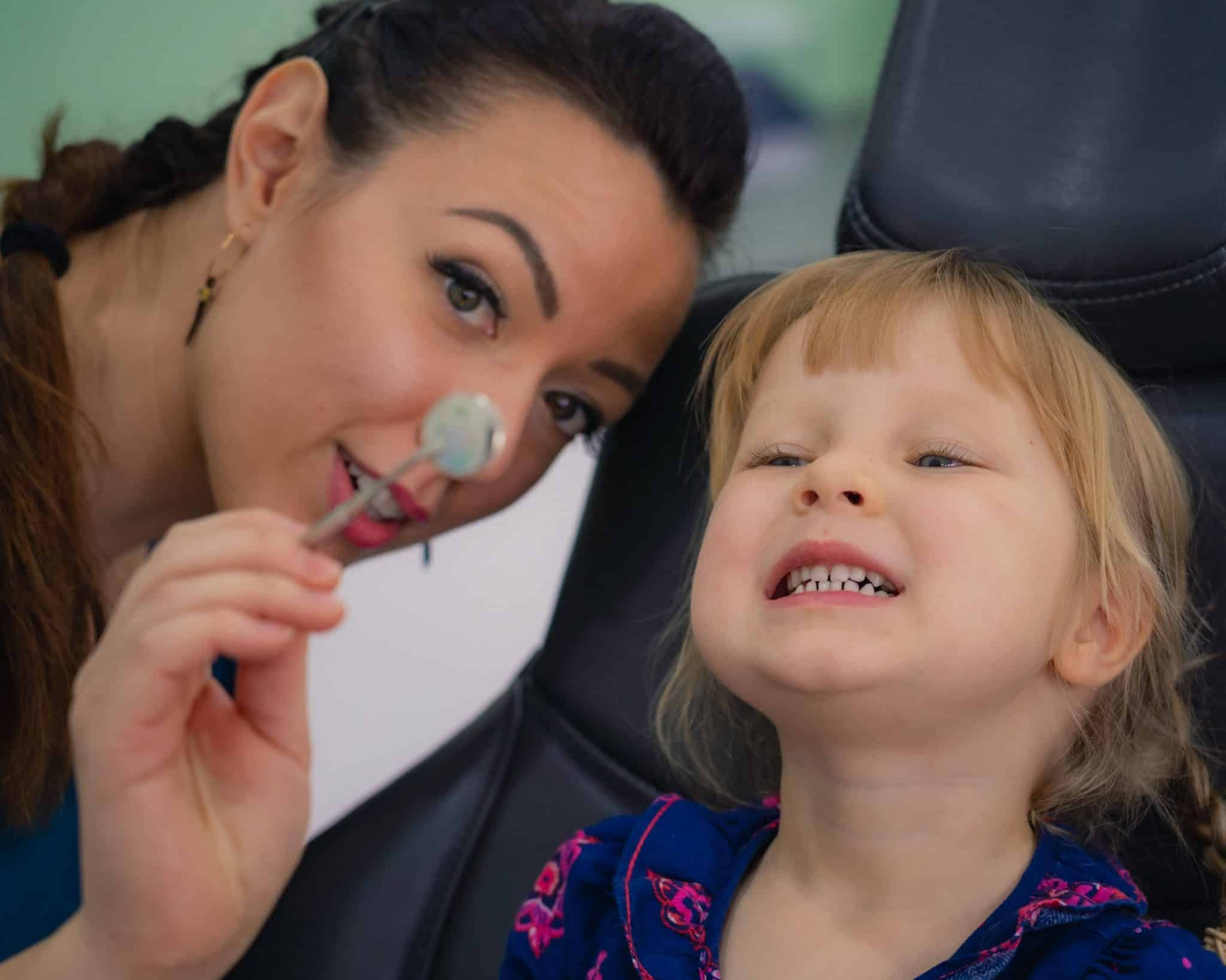 Dentist and a smiling child